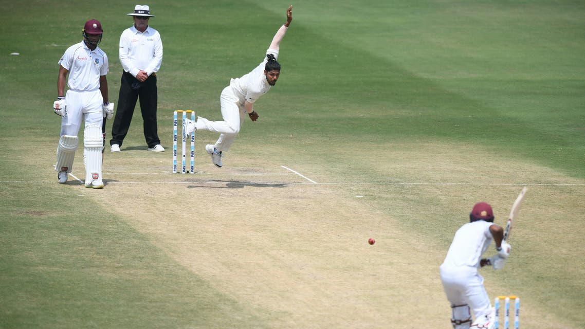 West Indies cricketer Shai Hope looks on as Indian Bowler Umesh Yadav bowls during the third day's play of the second Test cricket match between India and West Indies at the Rajiv Gandhi International Cricket Stadium in Hyderabad on October 14, 2018. (AFP)