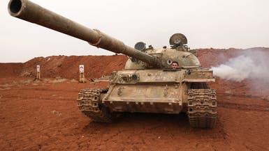 """إطلاق قذائف من المنطقة العازلة بإدلب رغم """"سحب السلاح"""""""