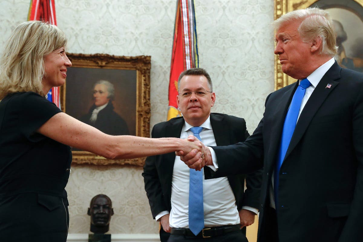Freed American pastor Andrew Brunson (C) looks on as his wife shakes hands with US President Donald Trump after a meeting in the Oval Office at the White House. (AFP)