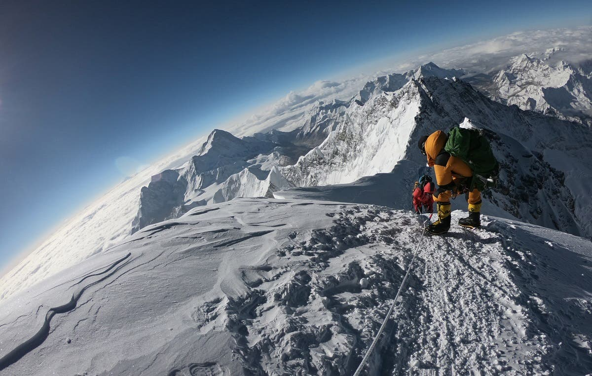 In this photo taken on May 17, 2018, mountaineers make their way to the summit of Mount Everest, as they ascend on the south face from Nepal. (AFP)
