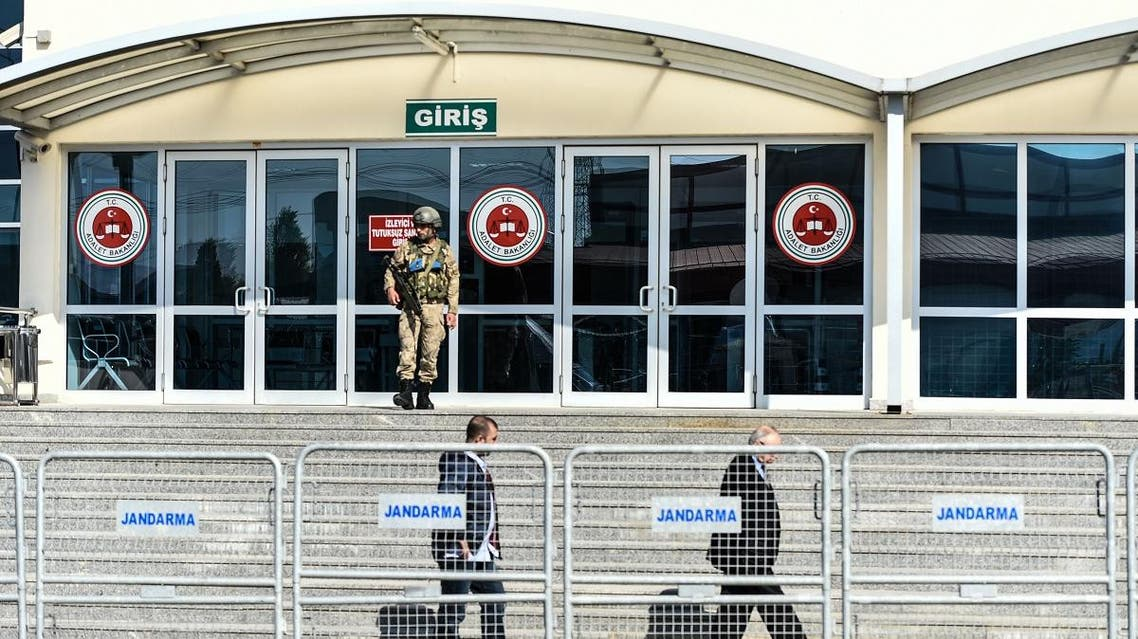 Turkish officers outside courthouse in Silivri district, Istanbul. A trial resumes on terror charges against 17 current and former staff from Cumhuriyet newspaper. (AFP)