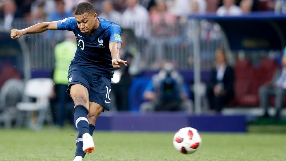 France's Kylian Mbappe scores his side's fourth goal during the final match between France and Croatia at the 2018 soccer World Cup. (AP)