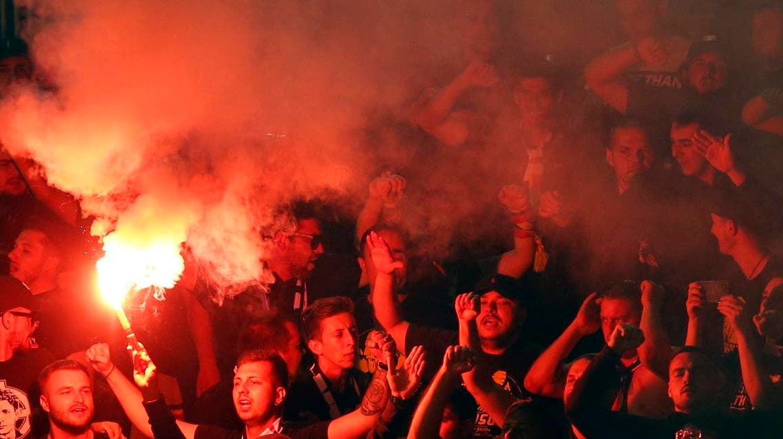 Romania fans light fireworks during the UEFA Nations League match between Serbia and Romania at Partizan stadium in Belgrade, Serbia. (AP)