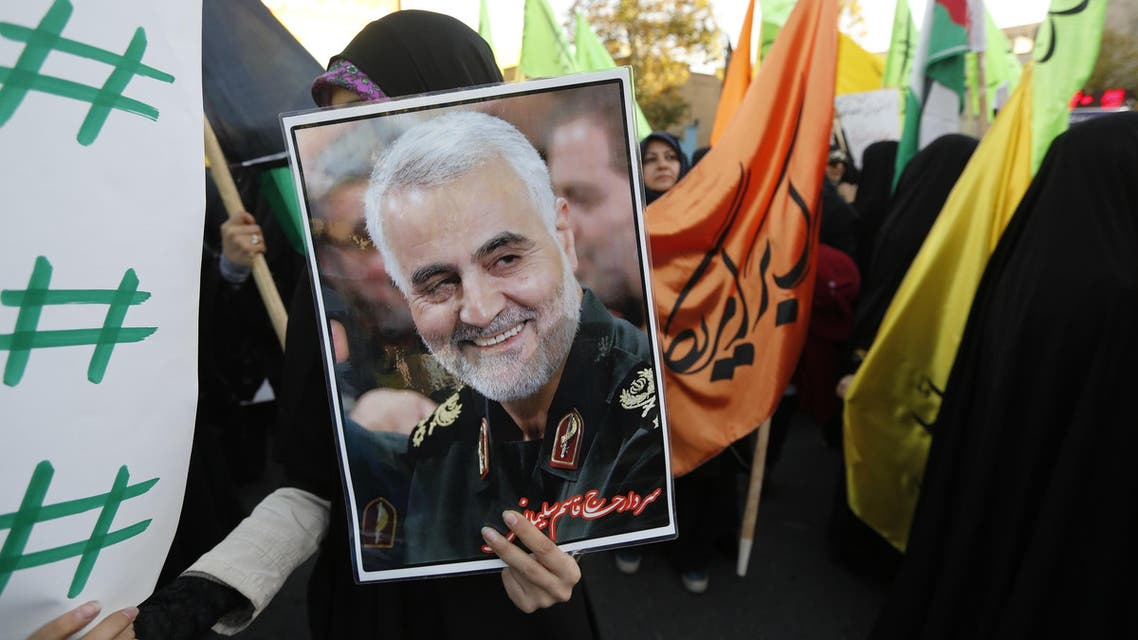 Iranian protesters hold a portrait of Gen. Qassem Suleimani, during a demonstration in Tehran on December 11, 2017. (AFP)
