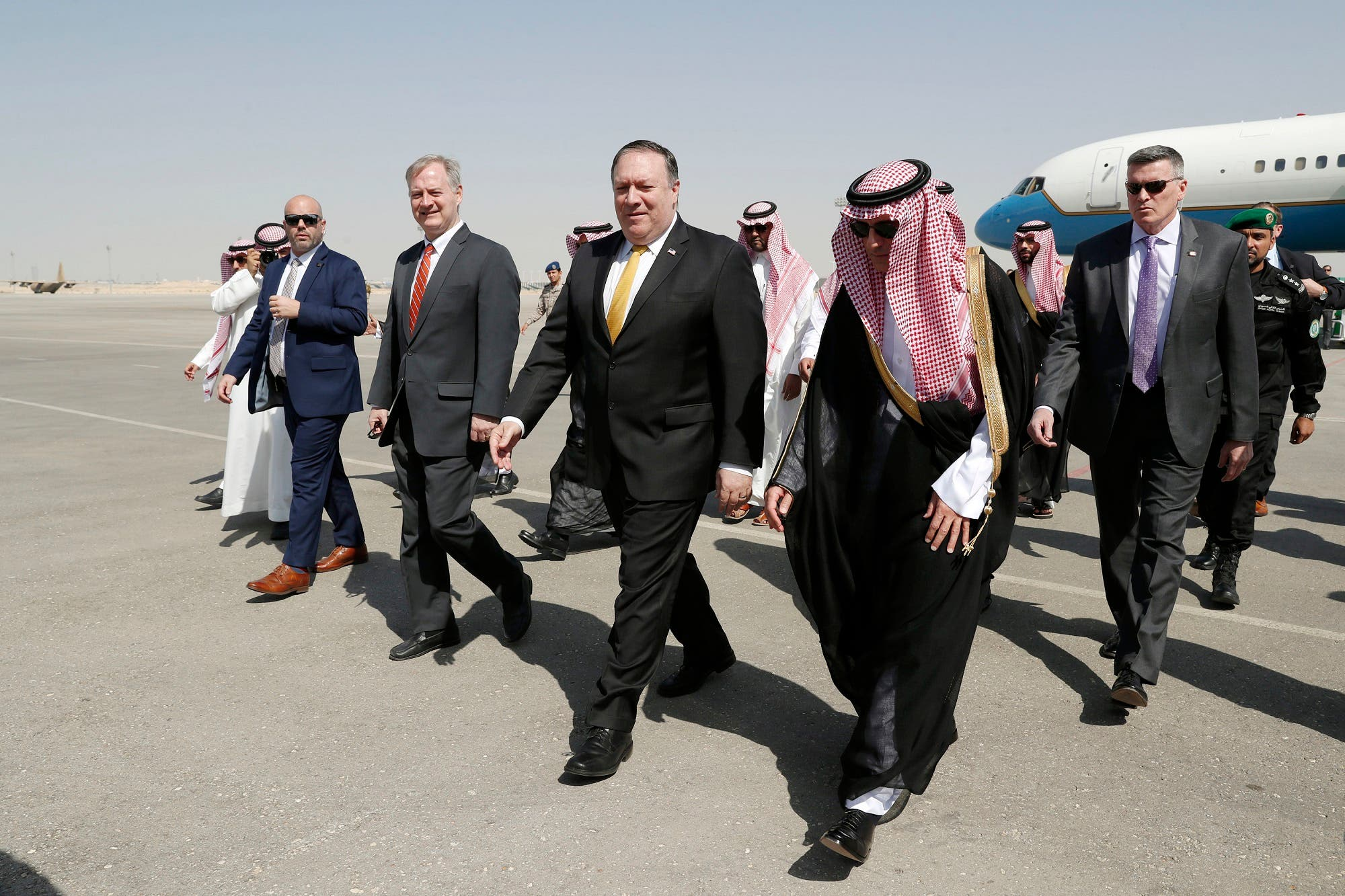U.S. Secretary of State Mike Pompeo, second right in front, walks with Saudi Foreign Minister Adel al-Jubeir after arriving in Riyadh, Saudi Arabia, Tuesday, Oct. 16, 2018. (AP)