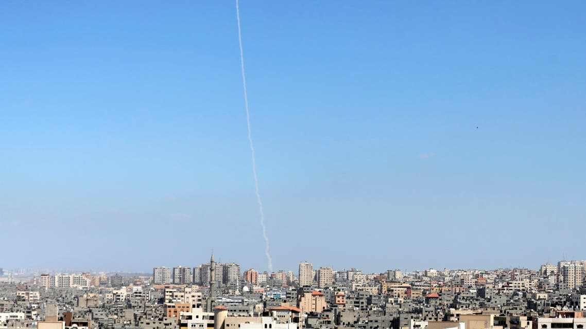 The smoke of a rocket fired by Palestinian Hamas militants is seen over Gaza City on March 25, 2018 as they take part in a military manouevre.
