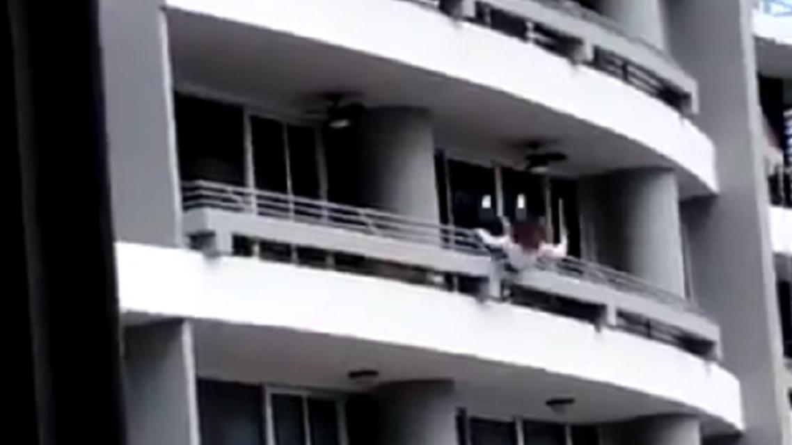 woman falls off balcony taking selfie