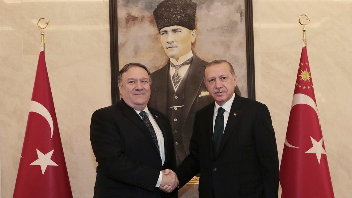Turkey's President Recep Tayyip Erdogan, right, and U.S. Secretary of State Mike Pompeo shake hands before a meeting at the Esenboga Airport in Ankara, Turkey, Wednesday, Oct. 17, 2018. (AP)