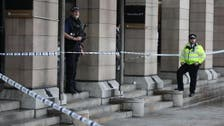 UK police shoot dead man brandishing knives near parliament