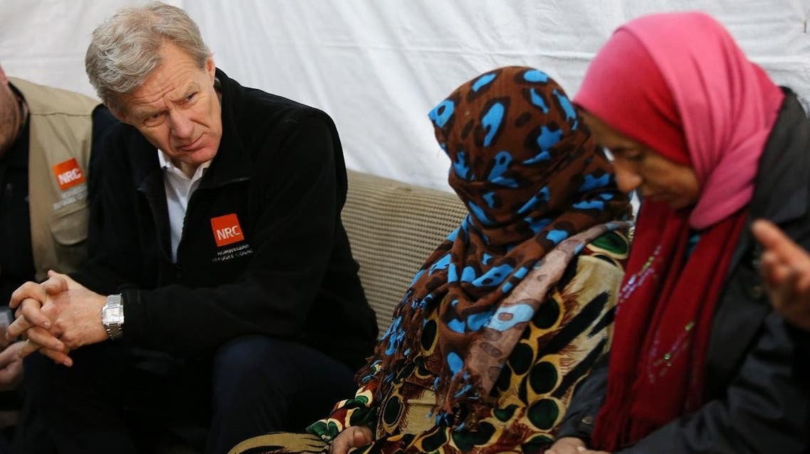 File photo of Jan Egeland, UN humanitarian adviser (left), meets with Syrian refugees at a camp in the town of Marej in the Bekaa valley, east Lebanon. (AP)