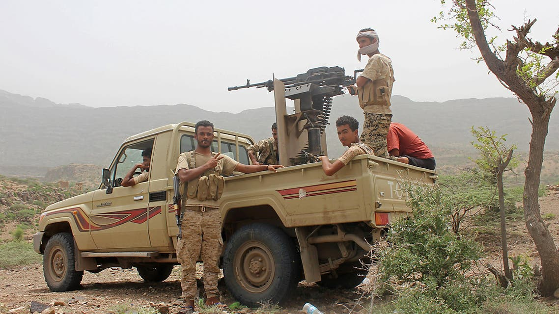Yemeni pro-government fighters sit at the back of an armed pick-up as Emirati supported forces take over Huthi bases on the frontline of Kirsh between the province of Taez and Lahj, southwestern Yemen, on July 1, 2018. The United Arab Emirates on Sunday announced it had halted the offensive it is backing against Huthi rebels in Yemen's port city of Hodeida to give a chance to UN diplomatic efforts.