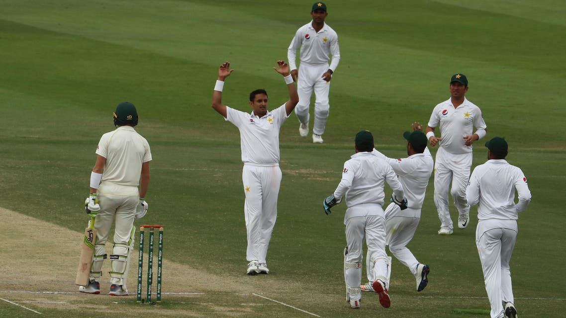 Pakistan cricketer Mohammad Abbas (2R) celebrates after dismissing Australian cricketer Marnus Labuschagne during day four of the second Test at Sheikh Zayed stadium in Abu Dhabi on October 19, 2018. (AFP)