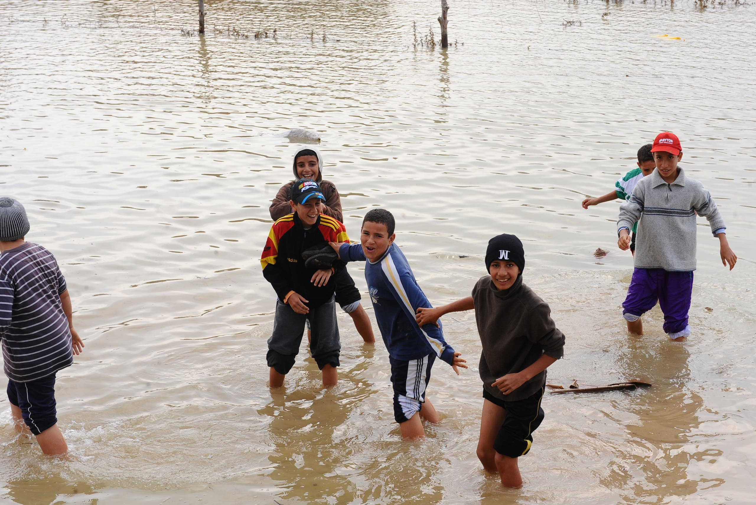 Kids play in floodwater in the northern Tunisia village of Houcine invaded with floodwater on November 2, 2011 near Majaz al Bab in Beja's province. (AFP)