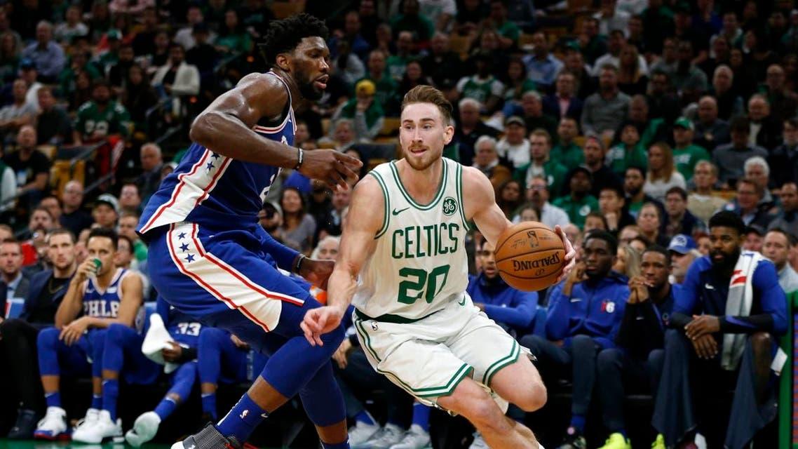 Boston Celtics guard Gordon Hayward drives past Philadelphia 76ers center Joel Embiid during the second half at TD Garden. (Greg M. Cooper/USA TODAY Sports)