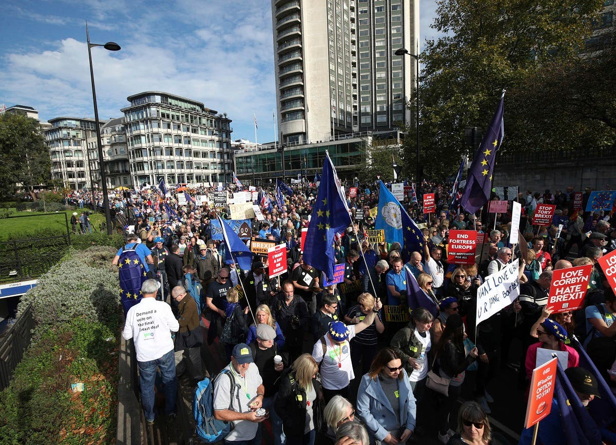 Thousands of protesters gathered in central London on Saturday to call for a second referendum on Britain's exit from the European Union. (AP)