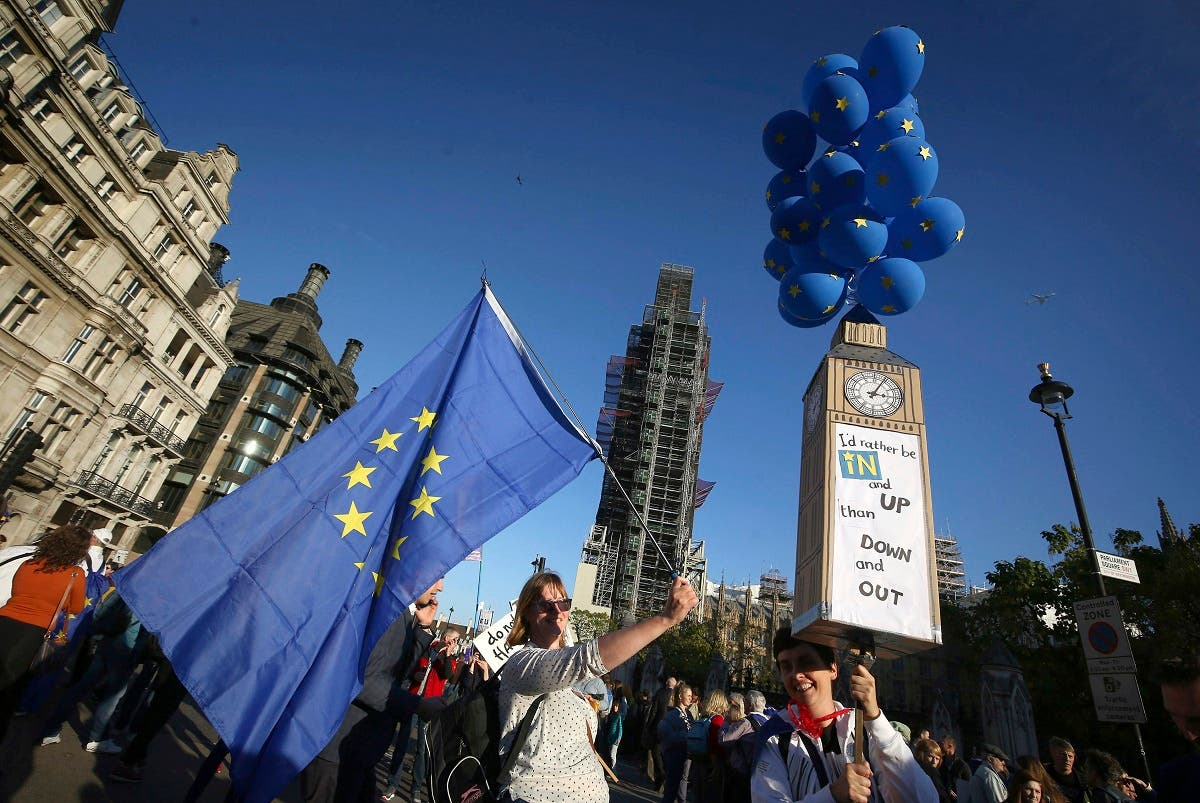 Anti-Brexit campaigners near to parliament during the People's Vote March in London, calling for a second EU referendum, in London, Saturday Oct. 20, 2018. (AP)
