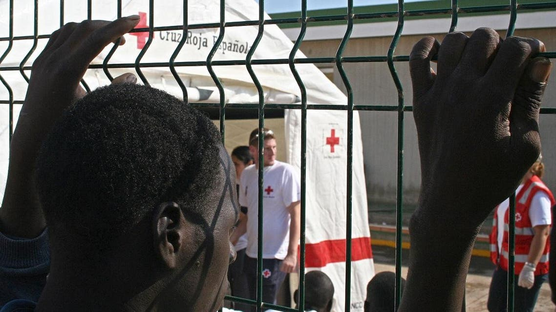 An immigrant looks at a Spanish Red Cross tent in Melila (AFP)