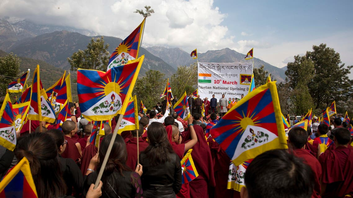 Exile Tibetans hold their national flags as they mark 58th anniversary of the March 10, 1959 Tibetan Uprising Day, in Dharmsala, India, on March 10, 2018. (AP)