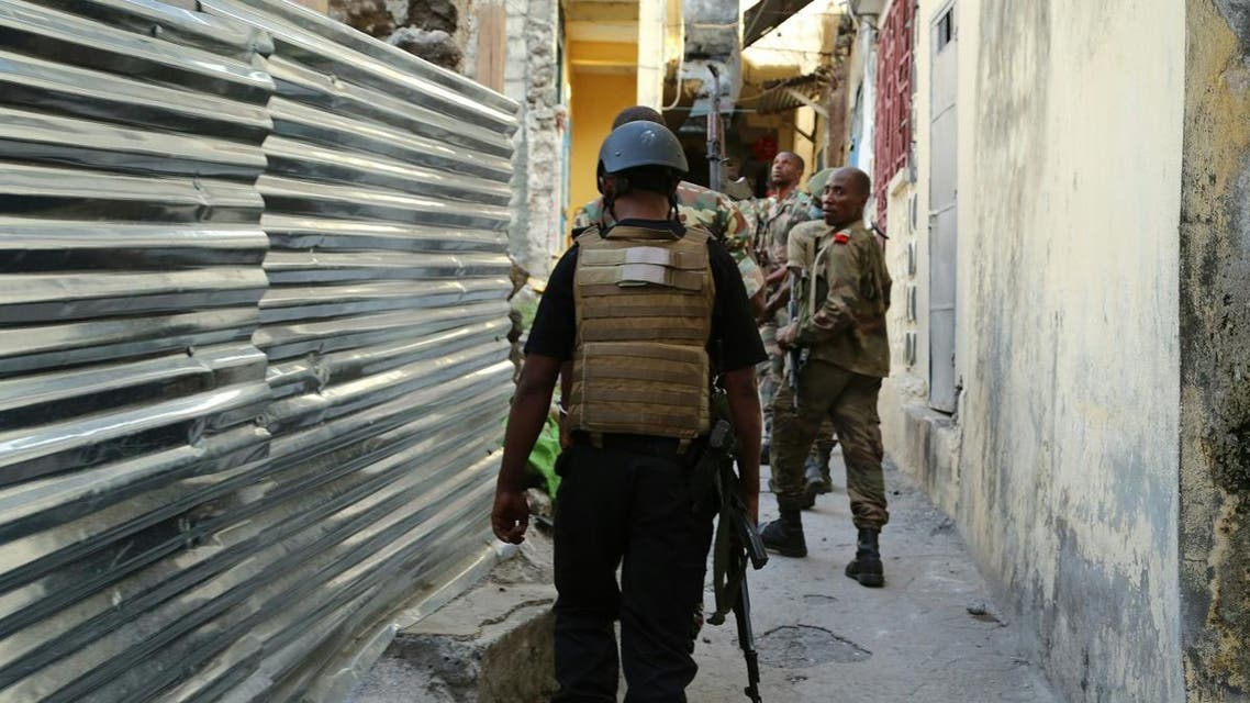 """Comoros Armed forces members search and patrol the """"Medina"""" for weapons and armed men at Mutsamudu. (AFP)"""