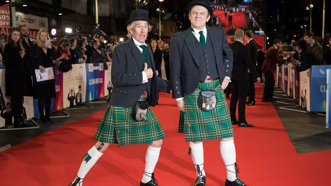 Actors Steve Coogan, left, and John C. Reilly pose for photographers upon arrival at the premiere of 'Stan and Ollie' at BFI London Film Festival on Oct. 21, 2018. (AP)