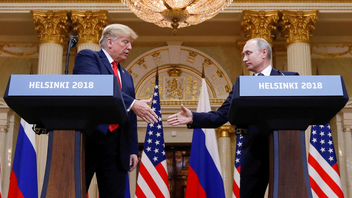 FILE PHOTO: U.S. President Donald Trump and Russia's President Vladimir Putin shake hands during a joint news conference after their meeting in Helsinki, Finland, July 16, 2018. REUTERS/Kevin Lamarque/File Photo