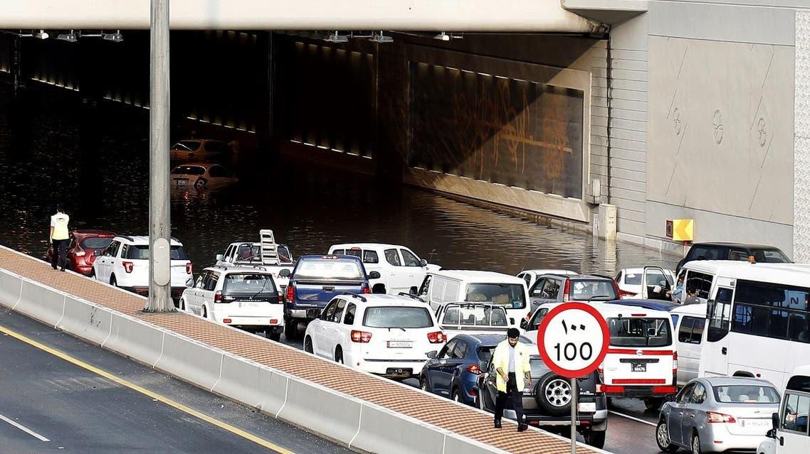Motorists drive through a flooded tunnel in the Qatari capital Doha, following heavy rainfall. (AFP)