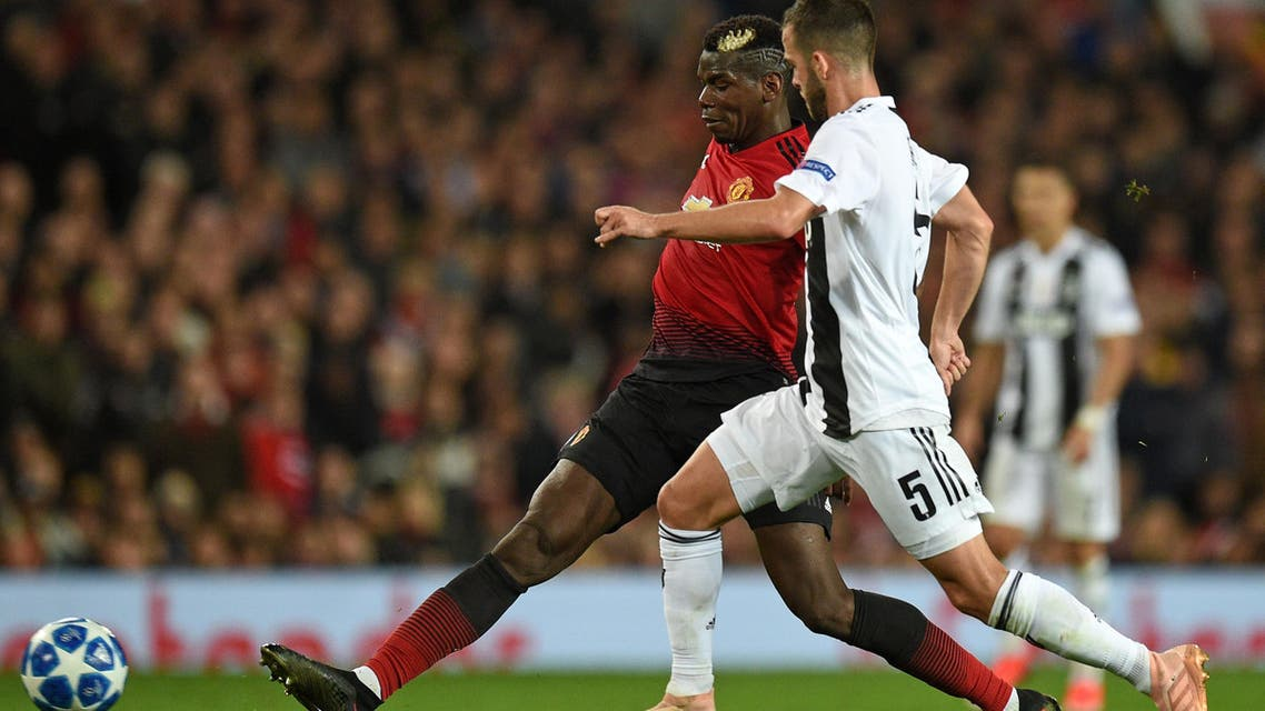Manchester United's French midfielder Paul Pogba (L) vies with Juventus' Bosnian midfielder Miralem Pjanic (R) during the Champions League group H football match at Old Trafford in Manchester, north west England, on October 23, 2018. (AFP)