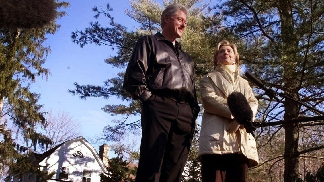 In this Jan. 6, 2000 file photo, Bill and Hillary Clinton stand in the driveway of their new home in Chappaqua, N.Y. (AP)