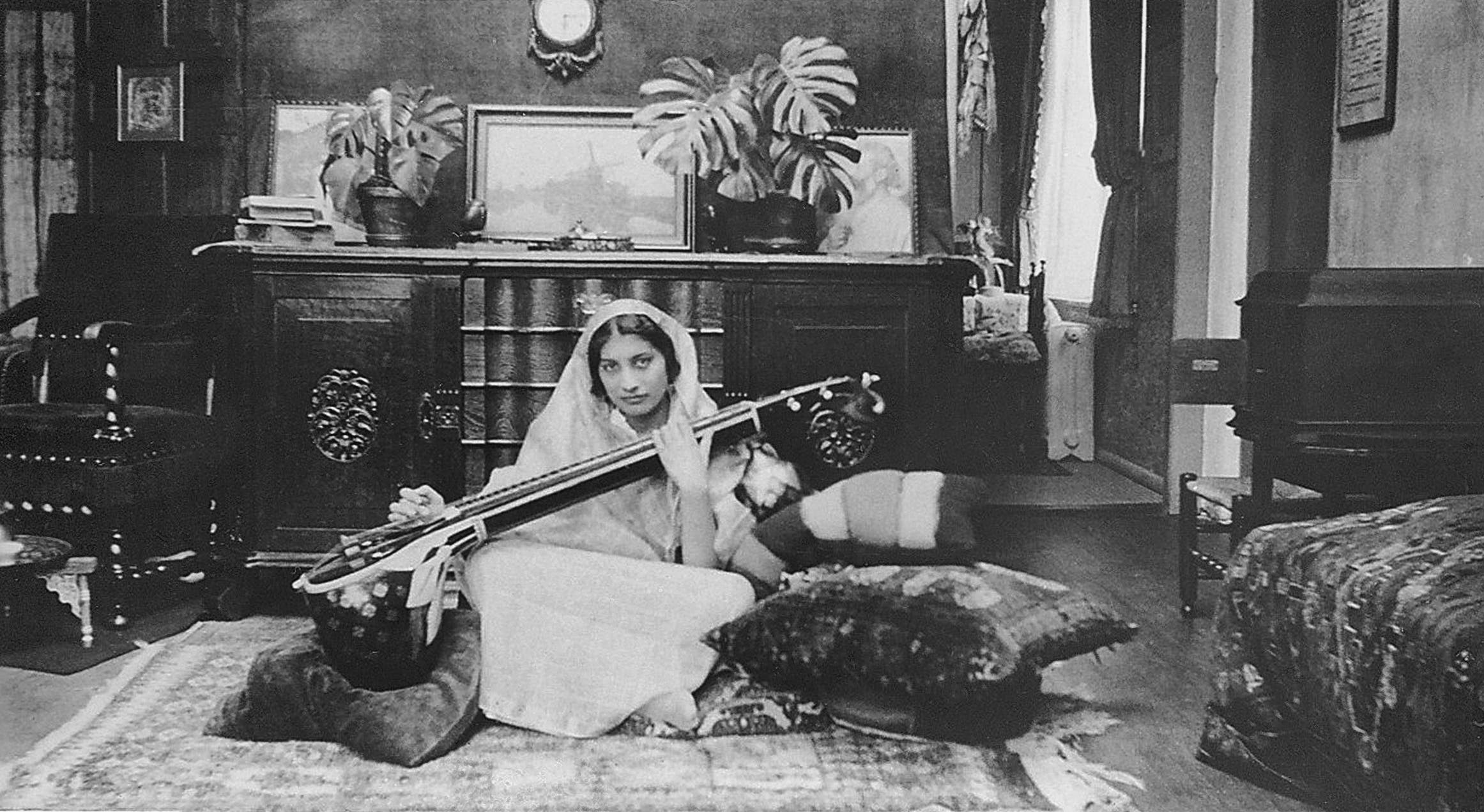 This handout picture received from Shrabani Basu at the Noor Inayat Khan Memorial trust on November 8, 2012 shows Noor Inayat Khan playing a Veena. (AFP)