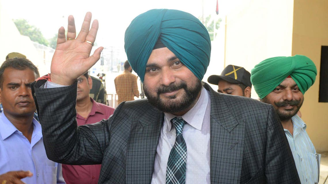 Navjot Singh Sidhu waves after crossing the India-Pakistan border in Wagah, about 35km from Amritsar, on August 19, 2018. (AFP)