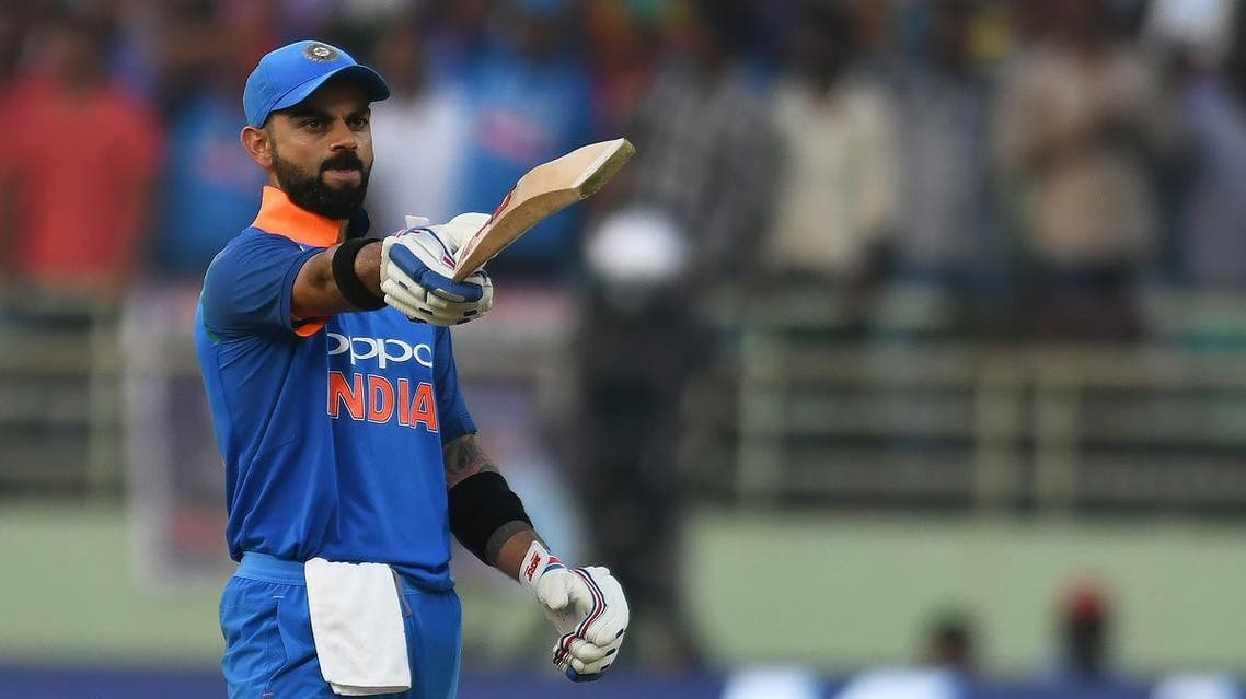 Indian cricket captain Virat Kohli raises his bat after scoring century (100 runs) during the second one day international (ODI) cricket match between India and West Indies at the Dr. Y.S. Rajasekhara Reddy ACA-VDCA Cricket Stadium in Visakhapatnam on October 24, 2018.  NOAH SEELAM / AFP