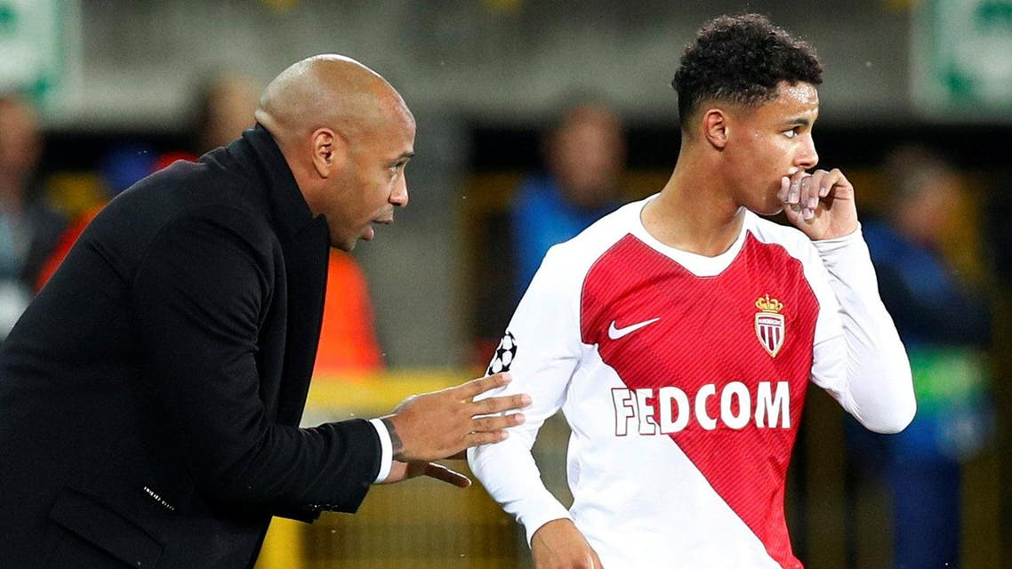 AS Monaco's Sofiane Diop receives instructions from coach Thierry Henry during the match. (Reuters)