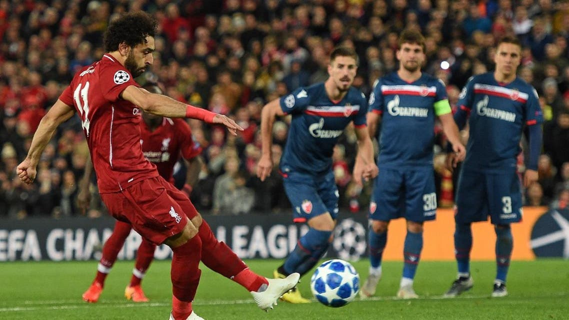 Liverpool's Egyptian midfielder Mohamed Salah (L) scores their third goal from the penalty spot during the UEFA Champions League group C football match between Liverpool and Red Star Belgrade at Anfield in Liverpool, north west England on October 24, 2018. (AFP)