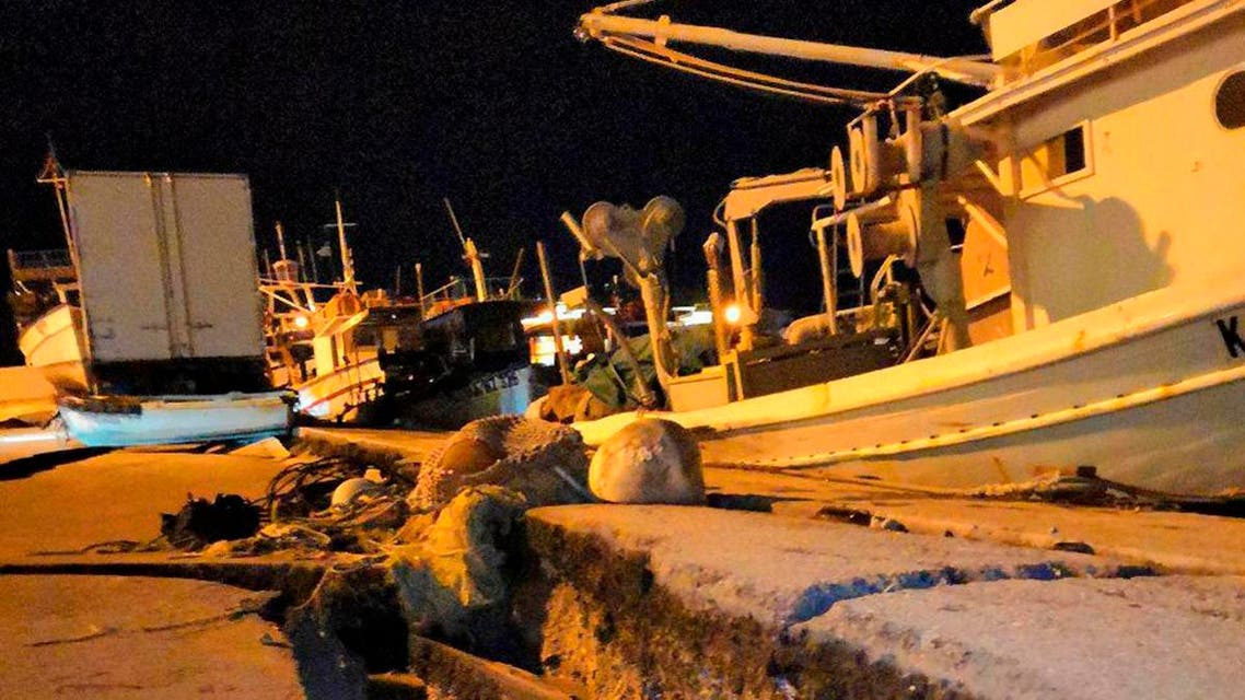 Damages are seen at the port of the western island of Zakynthos, Greece. (AP)