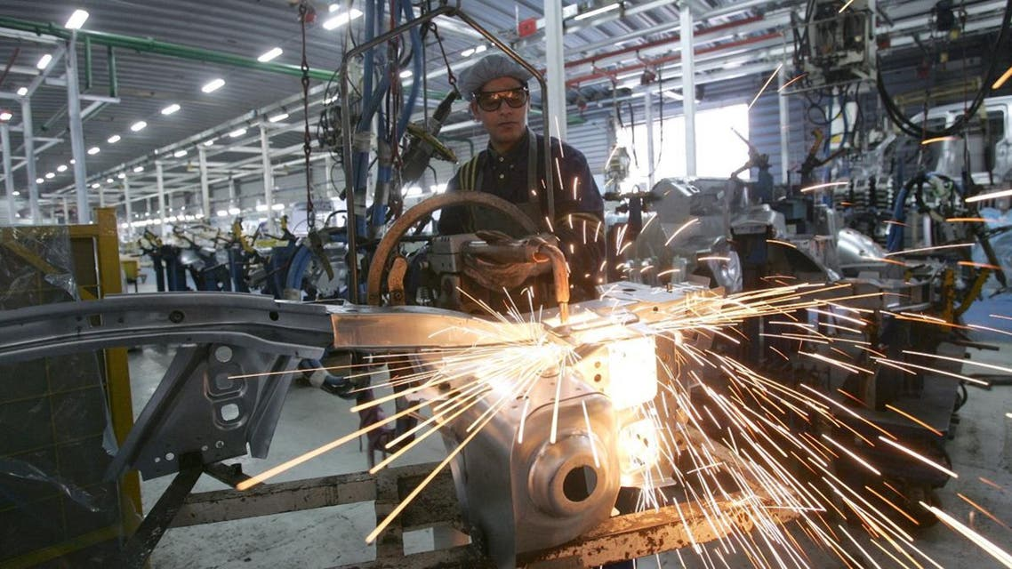 A Moroccan employee works in the Renault Logan welding and assembling department at the Somaca plant in Casablanca. (AFP)