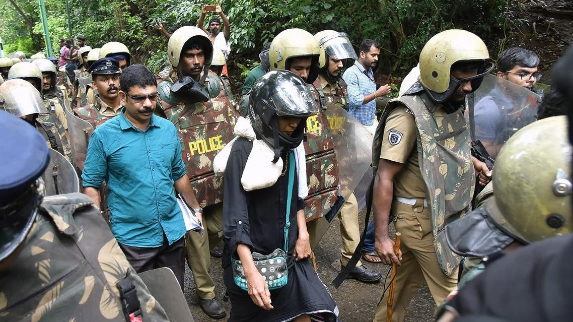Indian activist Rehana Fatima (C) walks with police wearing protective gear near the Lord Ayyappa temple complex at Sabarimala in India's southern Kerala state on October 19, 2018.  (AFP)