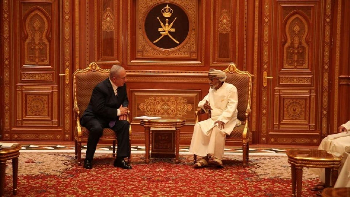 The late Omani Sultan Qaboos bin Said with Israeli Prime Minister Benjamin Netanyahu during the latter's visit to Oman. (AFP)