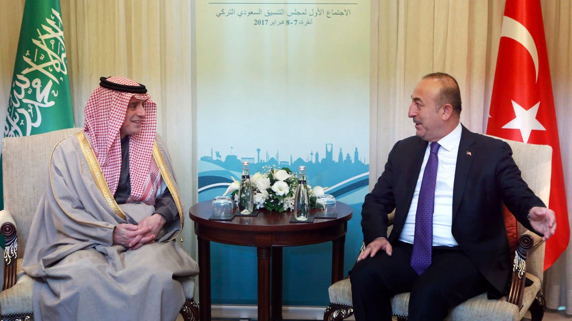 Turkish Foreign Minister Mevlut Cavusoglu (R) and Foreign Minister of Saudi Arabia Adel Al Jubeir (L) react during a meeting in Ankara, on February 8, 2017.