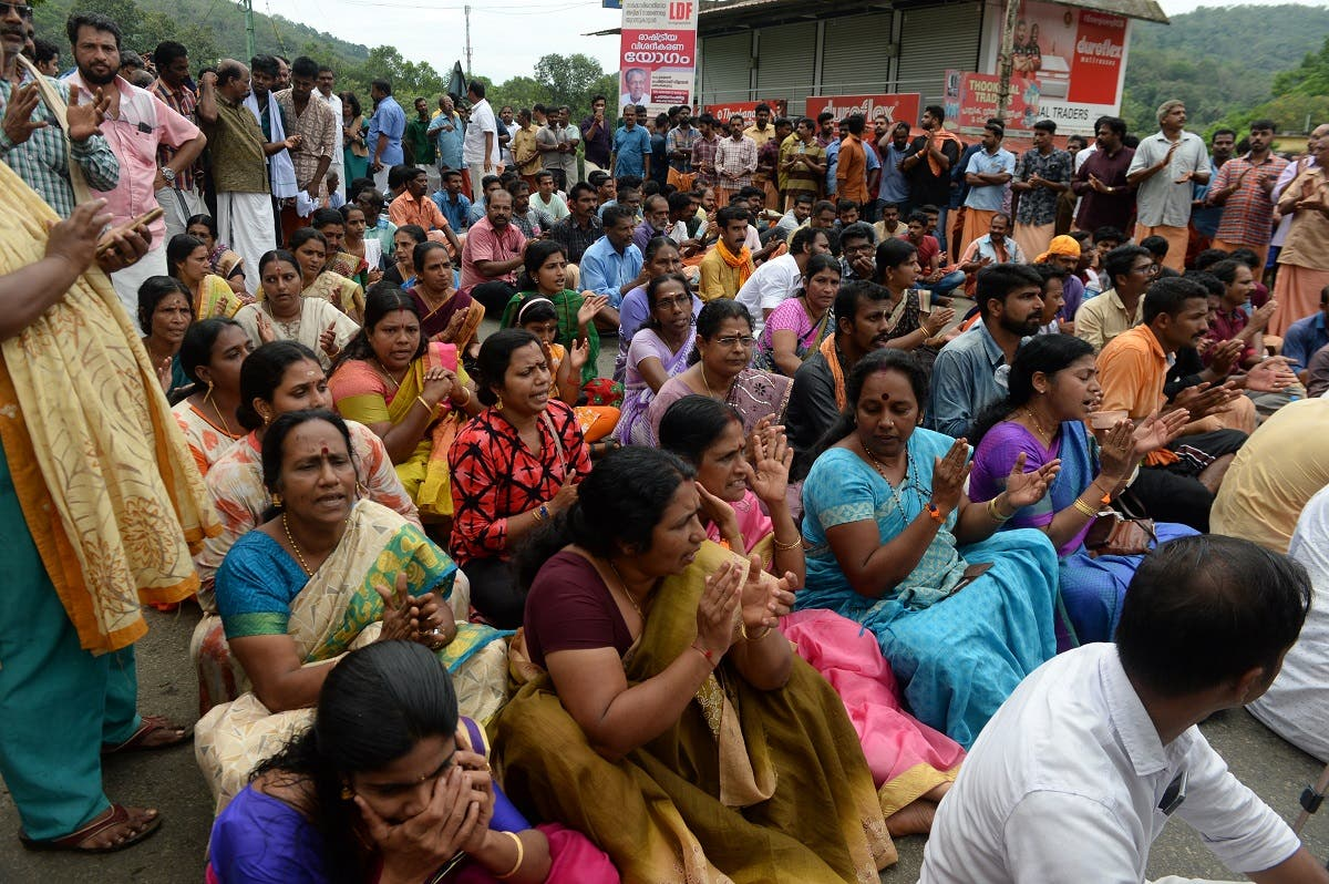 Hindu activists block a road to the Sabarimala Temple, at Vadaserikara town in Pathanamthitta district in India's southern Kerala state on October 19, 2018. (AFP)