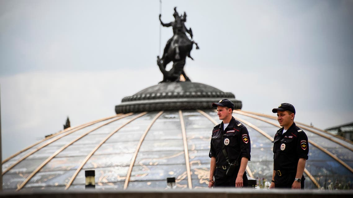 Russian police officers stand guard on Manezhnaya Square in downtown Moscow on July 13, 2018, two days before the Russia 2018 World Cup final football match between France and Croatia.