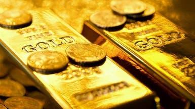 الذهب ينخفض مع ارتفاع الدولار وسط تلميحات برفع الفائدة