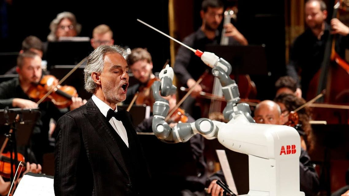 Humanoid robot YuMi conducts the Lucca Philharmonic Orchestra performing a concert alongside Italian tenor Andrea Bocelli at the Verdi Theatre in Pisa, Italy September 12, 2017. (Reuters)
