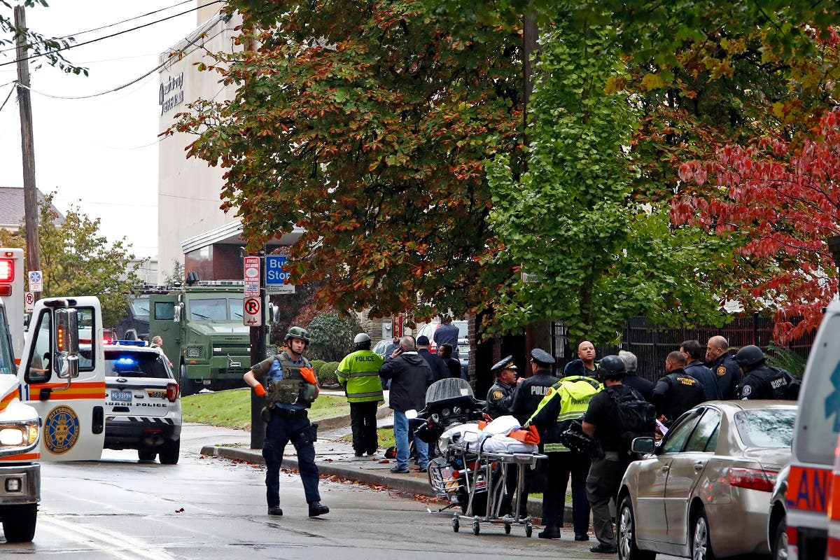 First responders surround the Tree of Life Synagogue in Pittsburgh, Pa., where a shooter opened fire. (Reuters)