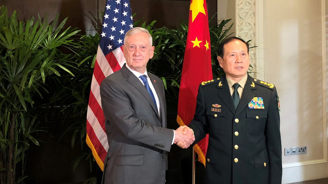 U.S. Defense Secretary Jim Mattis and China's Defense Minister Wei Fenghe greet each other ahead of talks in Singapore, October 18, 2018. REUTERSPhil Stewart