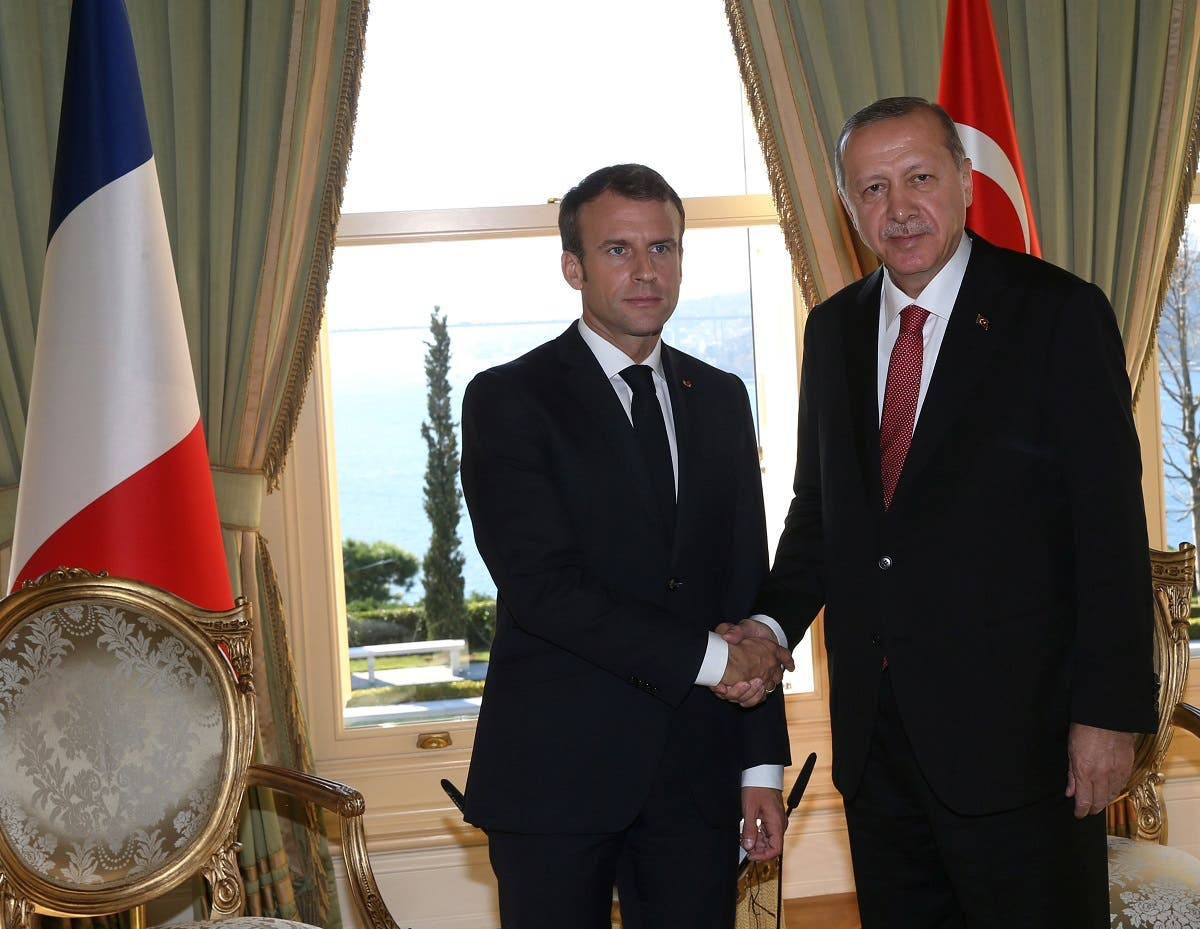 President Erdogan shakes hands with French President Emmanuel Macron prior to a summit on Syria, in Istanbul. (Reuters)