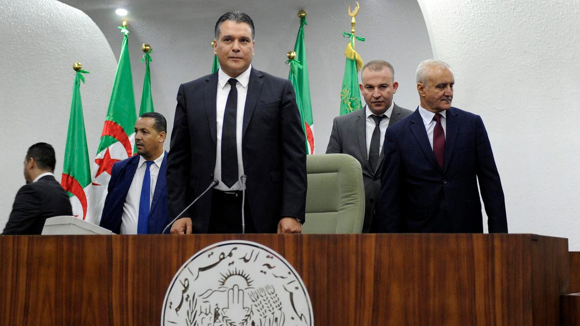 National Liberation Front's (FLN) member and newly elected president of parliament Mouad Bouchareb stands up at the president's platform of the Algerian National Assembly on October 24, 2018. The Algerian National Assembly (APN) elected on October 24, its new president, but the incumbent, Said Bouhadja, in open conflict with the parliamentary majority, proclaims itself still in office, leaving fears of a possible institutional imbroglio.
