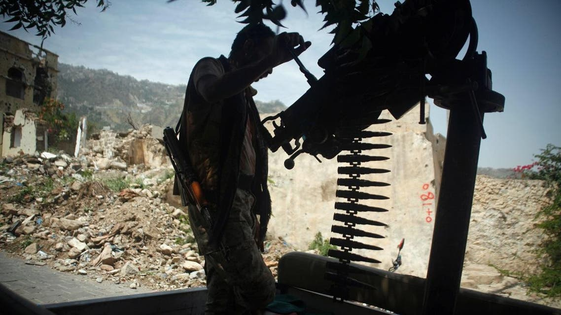 A government soldier mans a machine gun mounted on a patrol truck, at a neighbourhood the army took over, after clashes with armed militants in Taiz, Yemen August 14, 2018. (Reuters)