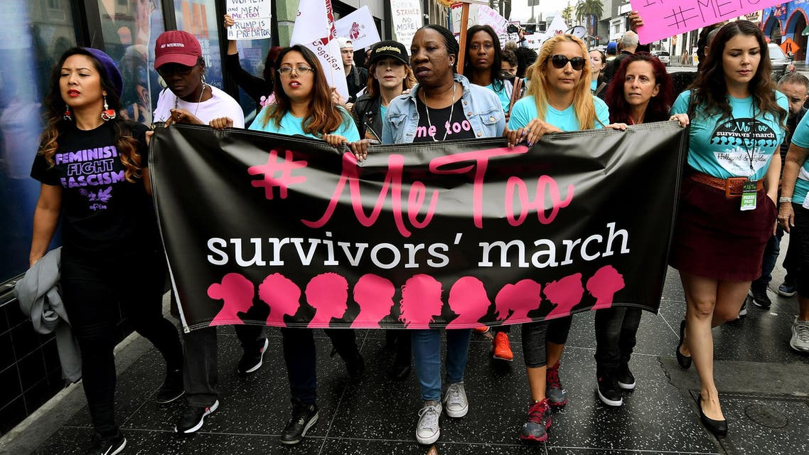 Women survivors of sexual harassment and their supporters protest during a #MeToo march in Hollywood, California on November 12, 2017. (AFP)