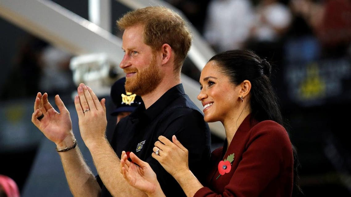 Prince Harry and Meghan, Duchess of Sussex, interact after handing out awards to the Invictus Games Sydney 2018 wheelchair basketball medallists at Quaycentre in Sydney, Australia. (Reuters)