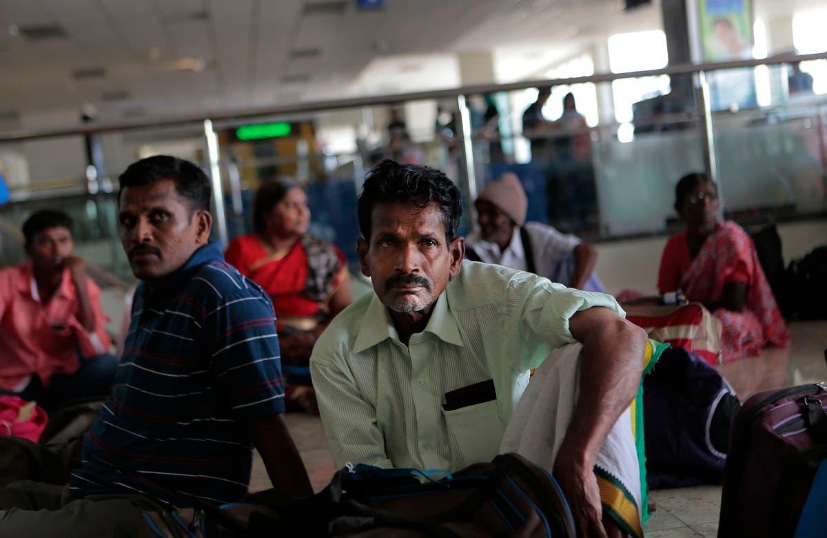 Sri Lankan ethnic Tamils who returned from southern India rest at the Bandaranaike international airport, Katunayake, Colombo, Sri Lanka. (File photo: AP)